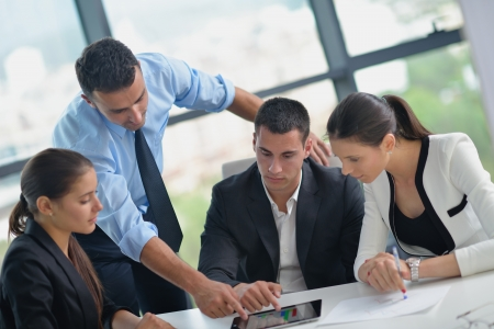 corporate training: Group of happy young  business people in a meeting at office Stock Photo