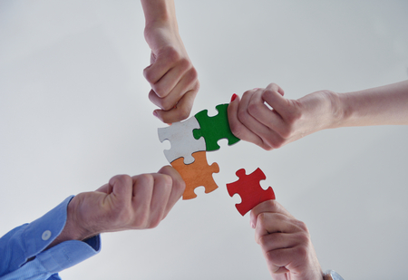 group business: Group of business people assembling jigsaw puzzle and represent team support and help concept