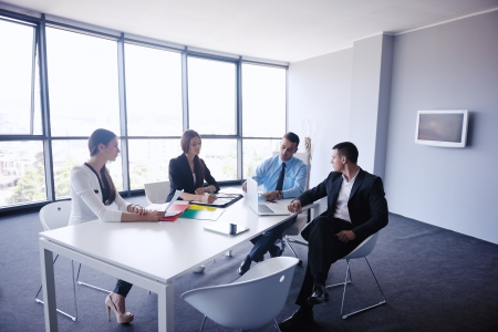 young office: Group of happy young  business people in a meeting at office Stock Photo