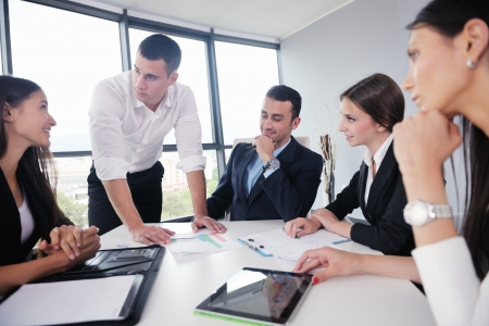 modern business lady: Group of happy young  business people in a meeting at office Stock Photo