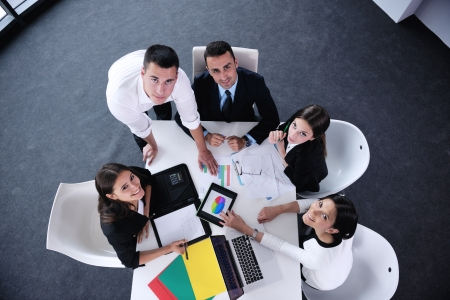 Group of happy young business people in a meeting at\ office
