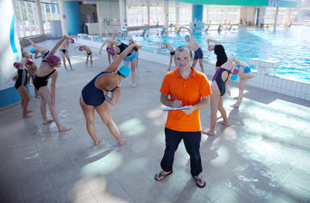 happy children kids group  at swimming pool class  learning to swim Stock Photo - 22777338