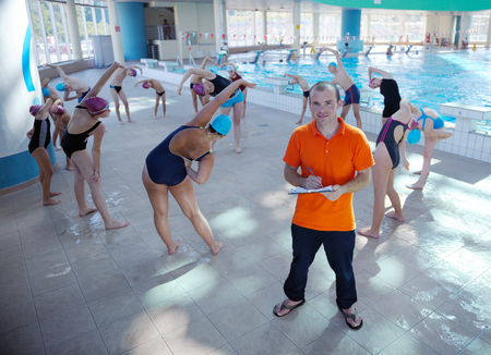happy children kids group  at swimming pool class  learning to swim Stock Photo - 22777339