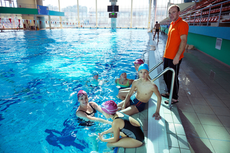 happy children kids group  at swimming pool class  learning to swim Stock Photo - 22777341