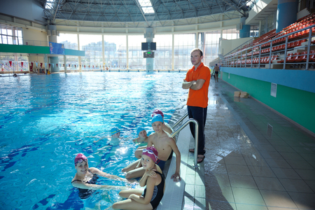 happy children kids group  at swimming pool class  learning to swim Stock Photo - 22777342
