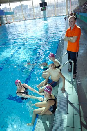 happy children kids group  at swimming pool class  learning to swim Stock Photo - 22777343
