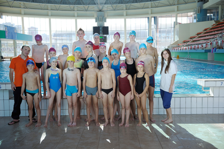 happy children kids group  at swimming pool class  learning to swim Stock Photo - 22777344
