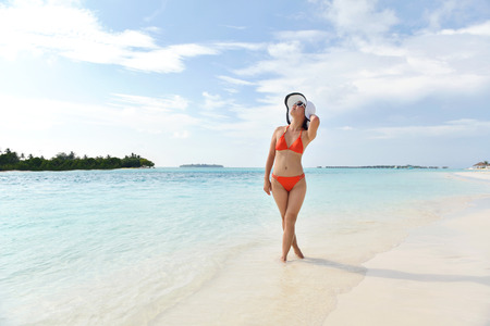 beautiful and happy woman girl on beach have fun and relax on summer vacation  over the sea photo