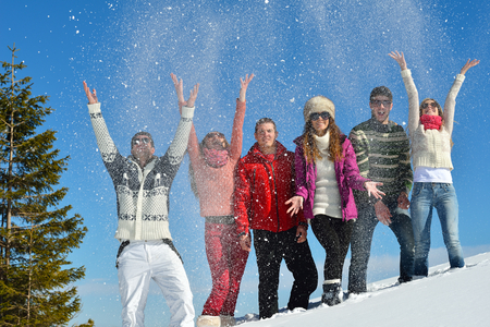 happy young people: happy young people group have fun and enjoy fresh snow at beautiful winter day