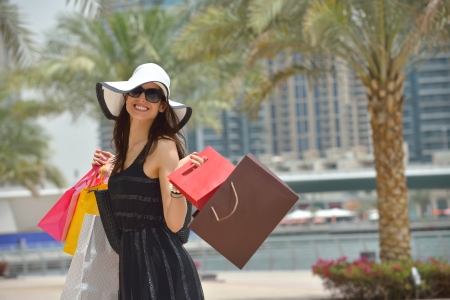 beautiful woman goes in shopping in the city photo