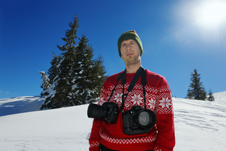 photographer portrait at beautiful winter day with fresh snow photo