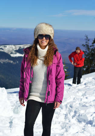 happy young woman having fun at winter nature landscape with\ fresh snow