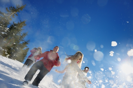 happy young people group have fun and enjoy fresh snow at beautiful winter day photo