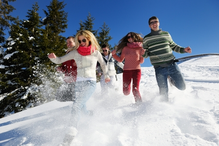 happy friends have fun at winter on fresh snow, healthy young people group outdoor photo