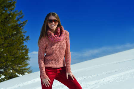 happy young woman having fun on winter vacation in beautiful nature landscape with fresh snow photo