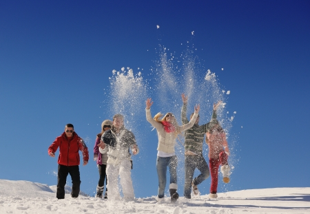 snow man party: happy friends group  have fun at winter on fresh snow, healthy young people outdoor Stock Photo