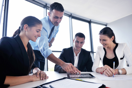 female executive: Group of happy young  business people in a meeting at office Stock Photo