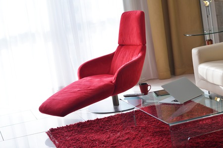 view of an elegant red couch: interior red chair design modern living room home Stock Photo
