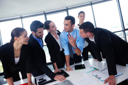Group of happy young  business people in a meeting at office Stock Photo - 24299500
