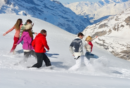 happy friends group  have fun at winter on fresh snow, healthy young people outdoor photo