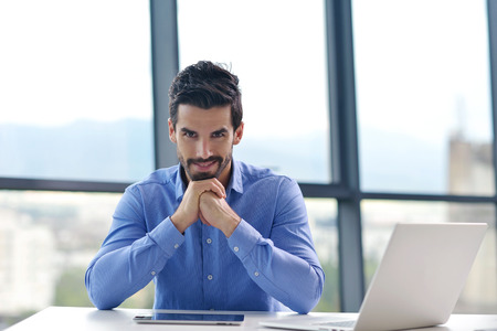 one adult: happy young business  man work in modern office on computer Stock Photo