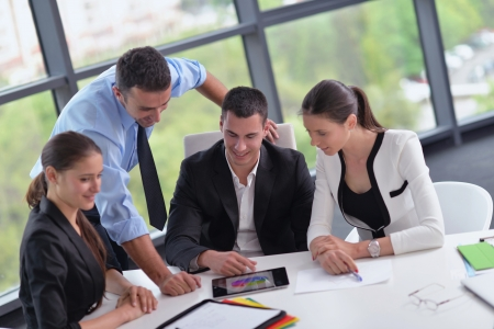 meeting together: Group of happy young  business people in a meeting at office Stock Photo