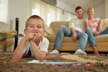 happy young family with kids in bright modern living room have fun and looking big flat lcd tv Stock Photo