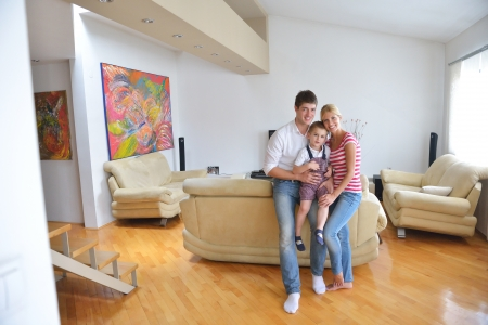 living room boy: happy young family with kids in bright modern living room have fun and looking big flat lcd tv Stock Photo