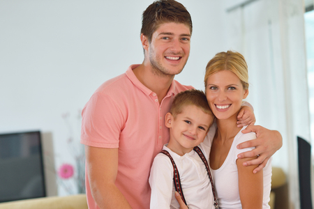 Happy Young Family With Kids In Bright Modern Living Room Have ...