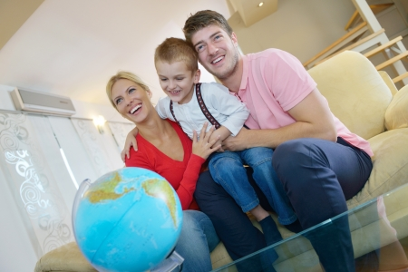 happy young family have fun with globe photo