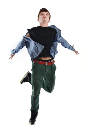 young boy man teen dancing and jumping isolated on white background in studio photo