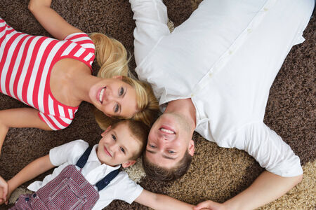 happy young family with kids in bright modern living room have fun and looking big flat lcd tv Stock Photo - 25288757