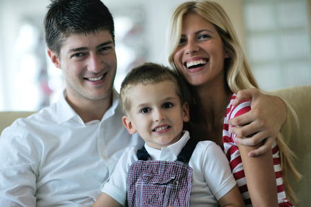 happy young family with kids in bright modern living room have fun and looking big flat lcd tv Stock Photo - 25378223