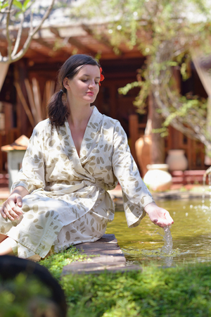 Woman getting spa treatment at tropical resort photo