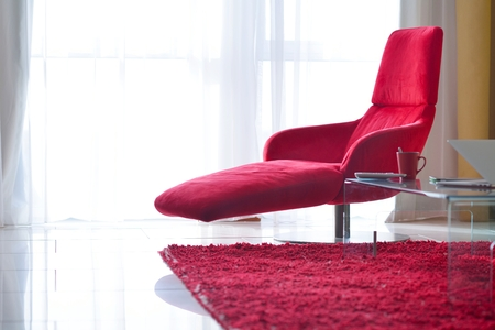 rug: interior red chair design modern living room home Stock Photo