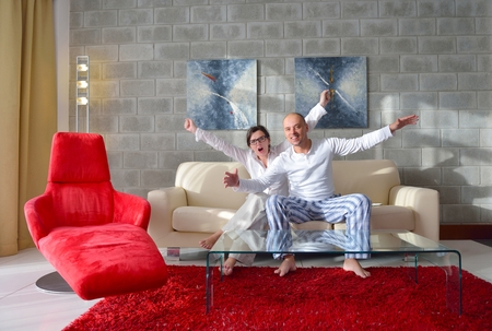 happy young couple relax at modern home living room indoor photo