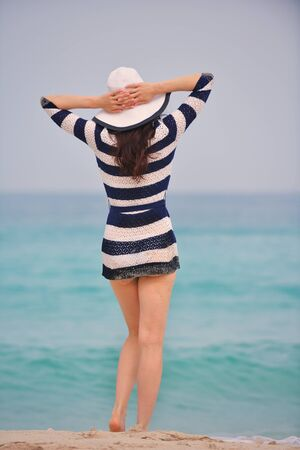 Happy Beautiful Woman Enjoying Summer Vacation on beach photo