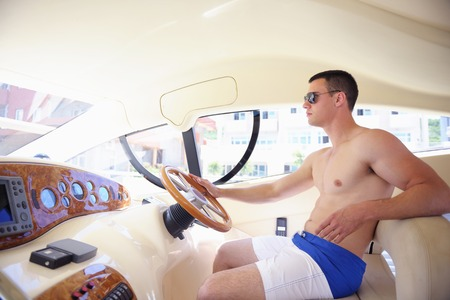 captain ship: young happy man have fun on luxury boat yacht