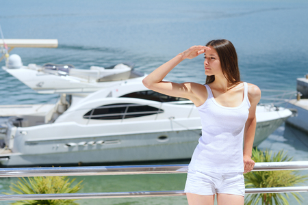 woman lies on a luxury yacht in the sea and looking to the horizon photo