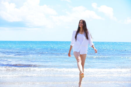 beautifel and happy woman girl on beach have fun and relax on summer vacation  over the beautiful tropical sea photo
