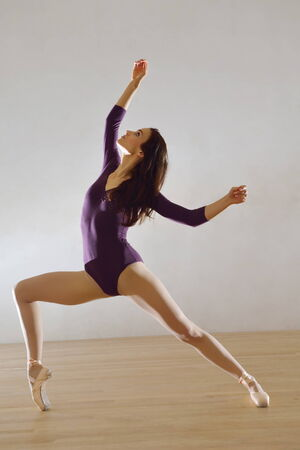 modern style ballet dancer posing and jumping on training photo