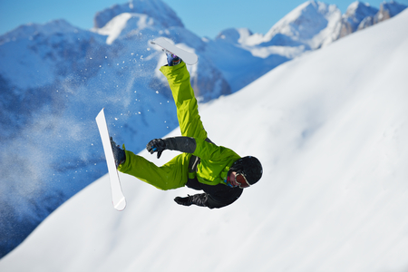 jumping skier at mountain winter snow fresh suny day photo
