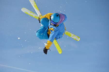 jumping skier at mountain winter snow fresh suny day Stock Photo - 27910357