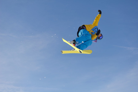 suny: jumping skier at mountain winter snow fresh suny day