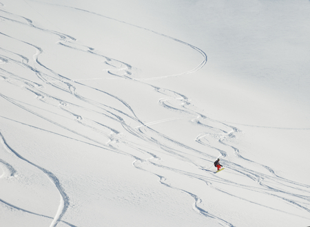 jumping skier at mountain winter snow fresh suny day Stock Photo - 28024865