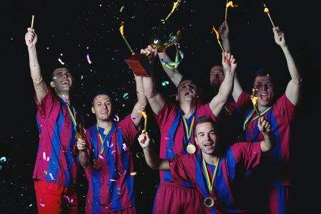 sports wear: soccer players team group celebrating the victory and become champion of game while holding win coup