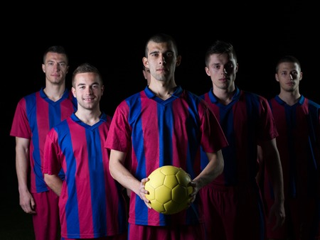 soccer players team group isolated on black background photo