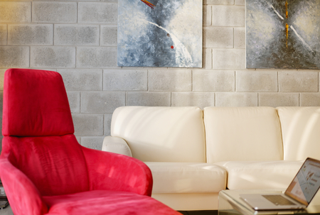 view of an elegant red couch: modern sofa Stock Photo