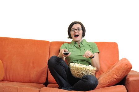 young woman eat popcorn, watching movies and eat popcorn at modern home living room  isolated on white background photo