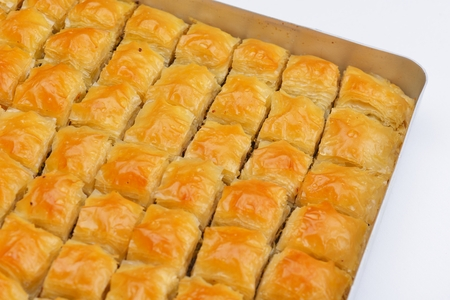 traditional dessert turkish baklava,well known in middle east and delicious isolated on white background photo